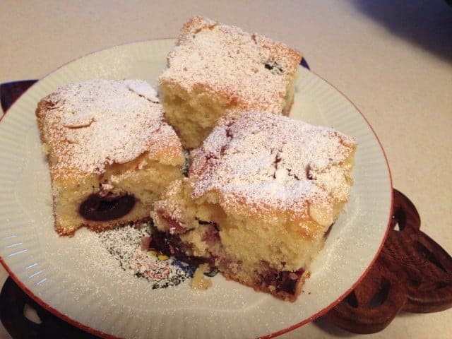Romanian Pound Cake with Fruits and Almond Flakes